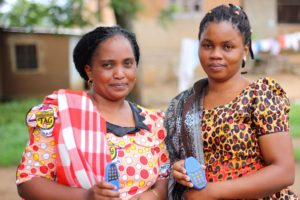 Two African women holding audio devices